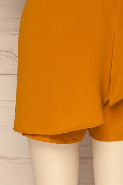 Durnstein Mustard Yellow Wrap-Style Romper | La Petite Garçonne bottom close-up