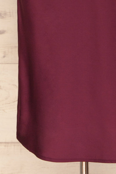 Enea Burgundy Satin Midi Slip Cocktail Dress | La Petite Garçonne bottom close-up