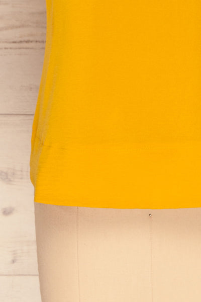 Fallet Yellow Boxy Short Sleeved Top | La Petite Garçonne bottom close-up