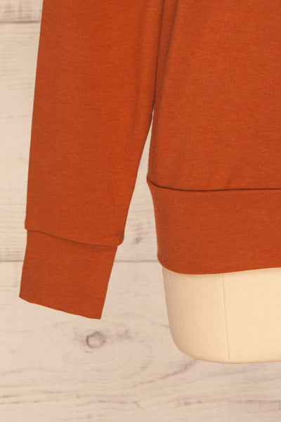 Fasseland Clay Burnt Orange Long Sleeved Top | La Petite Garçonne bottom close-up
