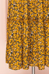Flamands Yellow Floral Midi Dress with Long Sleeves | Boutique 1861 bottom close-up