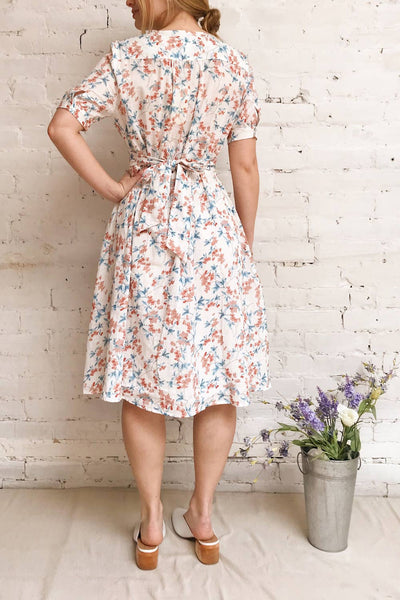 Frieda White Floral Short Sleeve Midi Dress | Boutique 1861 model back