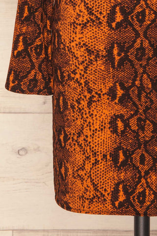 Gliwice Arancia Orange Snake Pattern Dress | BOTTOM CLOSE UP | La Petite Garçonne