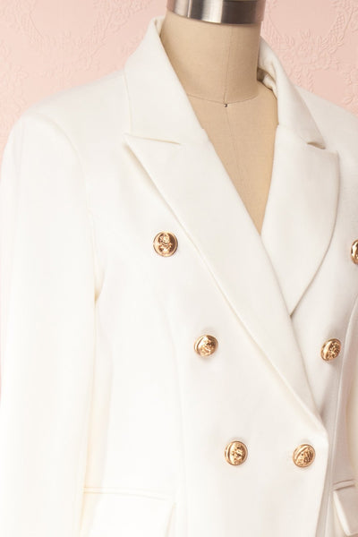 Jatayu White Tailored Jacket w/ Gold Buttons side close up | Boudoir 1861