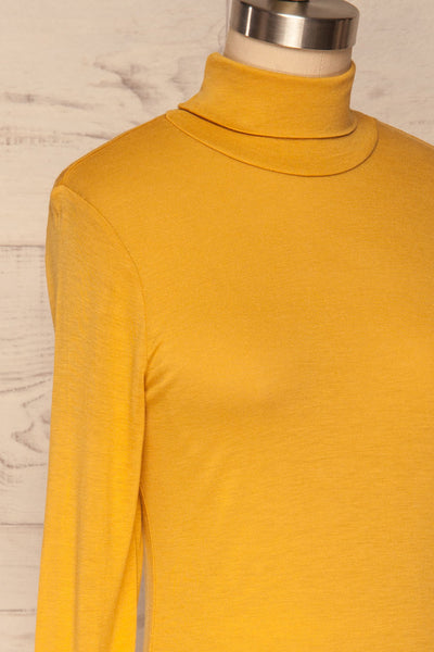Kamien Citrine Mustard Yellow Turtleneck Top | SIDE CLOSE UP | La Petite Garçonne