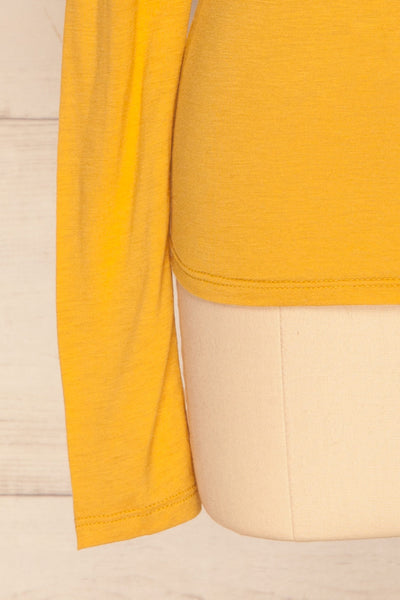 Kamien Citrine Mustard Yellow Turtleneck Top | BOTTOM  CLOSE UP | La Petite Garçonne