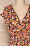 Karpacz Blue & Orange Floral Romper | La Petite Garçonne front close up