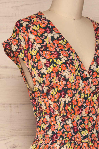 Karpacz Blue & Orange Floral Romper | La Petite Garçonne side close up