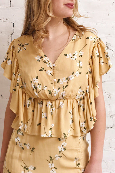 Katalina Yellow Floral Short Sleeve Top | Boutique 1861 on model