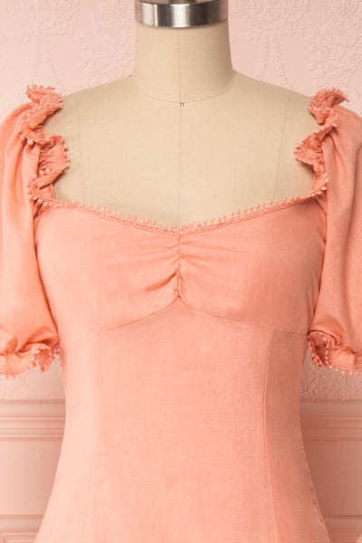 Ketayap Coral Pink Midi Dress w/ Puffy Sleeves | Boutique 1861 front close up