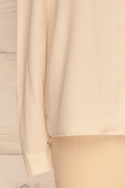 Kovin Cream Long Sleeve Blouse | La petite garçonne bottom close-up