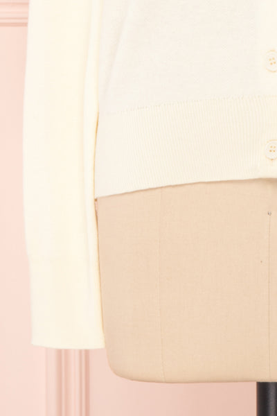 Kuzma Cream Knit Button-Up Cardigan with Lace | Boutique 1861 bottom close-up