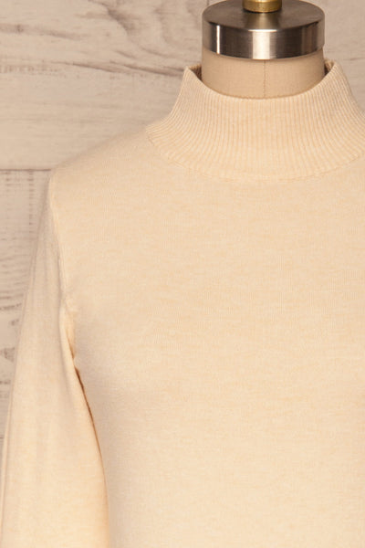 Kuznia Cream Long Sleeve Mock Neck Top | La petite garçonne front close up