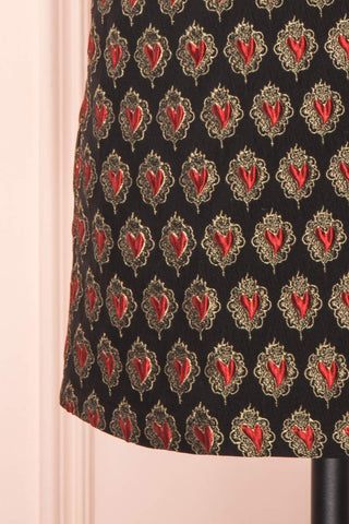 Larysa Black & Red Heart Pattern Cocktail Dress | Boutique 1861 bottom close-up