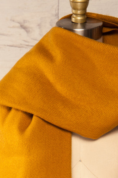 Le Baiser Mustard Soft Knitted Scarf | La petite garçonne wrap close-up