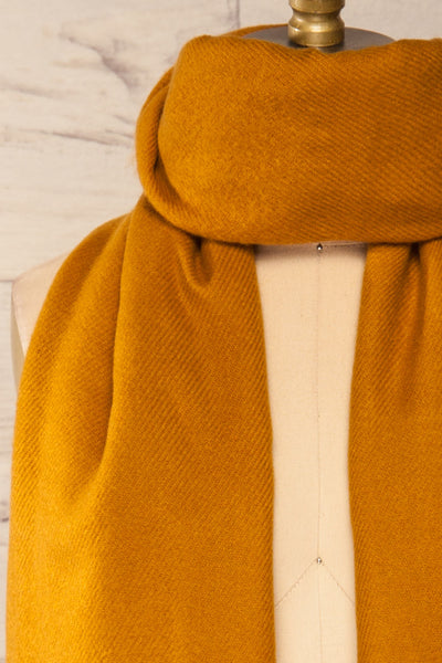 Le Baiser Mustard Soft Knitted Scarf | La petite garçonne cross close-up