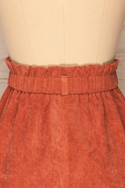 Loxley Clay Orange Corduroy Mini Skirt | La Petite Garçonne back close-up