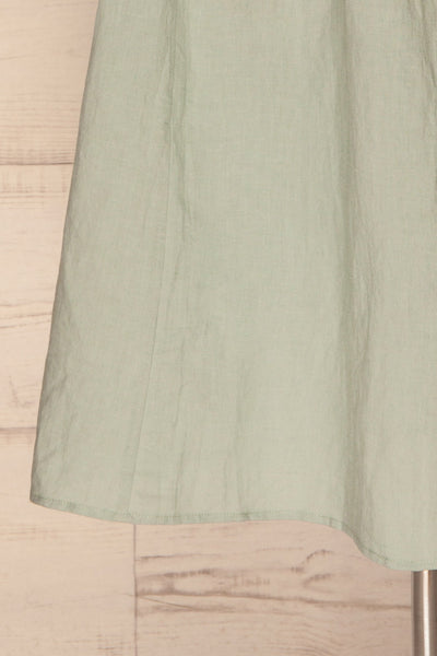 Lucani Blue-Green Faux-Wrap Midi Dress | La petite garçonne bottom close-up