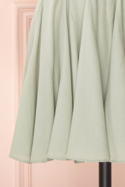 Lyana Light Green Faux-Wrap Short Dress | Boutique 1861 bottom