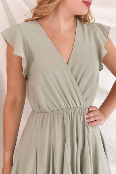 Lyana Light Green Faux-Wrap Short Dress | Boutique 1861 on model