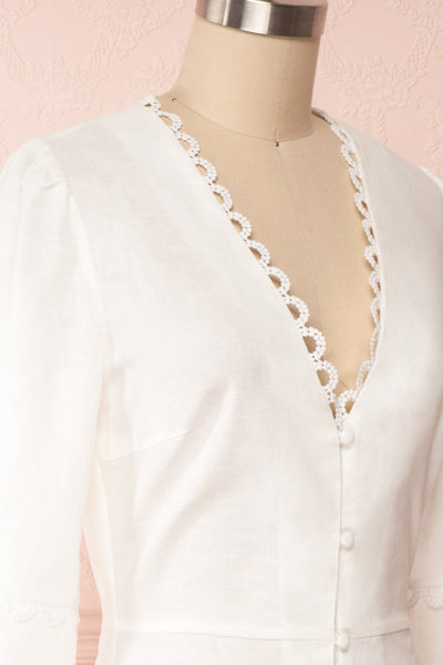Lysistrata White Short Dress w/ 3/4 Sleeves | Boutique 1861 side close up