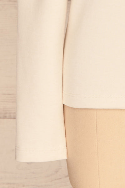 Methon Chalk White Mock Neck Top | Haut | La Petite Garçonne bottom close-up