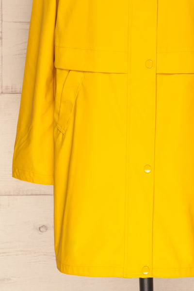 Oldham Yellow Matte Raincoat | La Petite Garçonne bottom close up