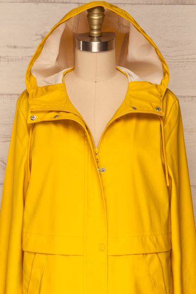 Oldham Yellow Matte Raincoat | La Petite Garçonne front close up hood