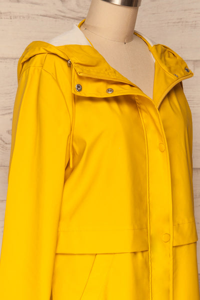 Oldham Yellow Matte Raincoat | La Petite Garçonne side close up