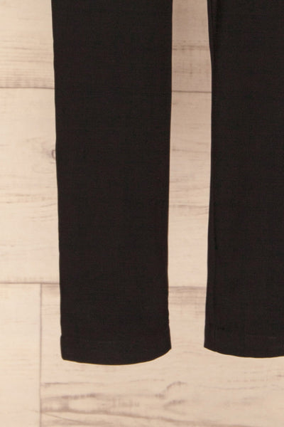 Orestiada Black Jumpsuit with Long Puff Sleeves | La Petite Garçonne bottom close-up