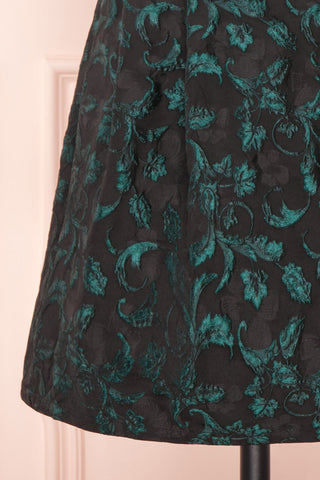 Orynko Black Cocktail Dress with Green Embroidery | Boutique 1861 bottom close-up