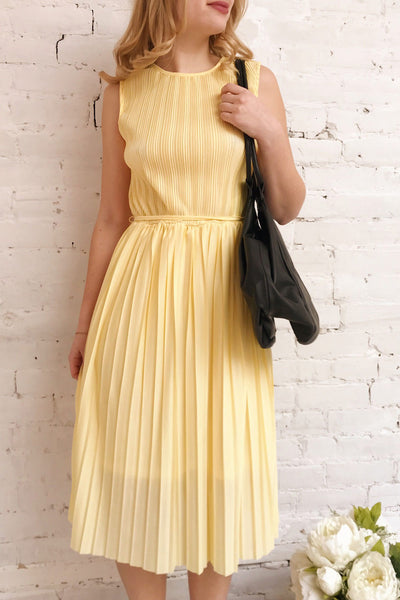 Ostra Sun Yellow Pleated Midi Dress | Boutique 1861 on model