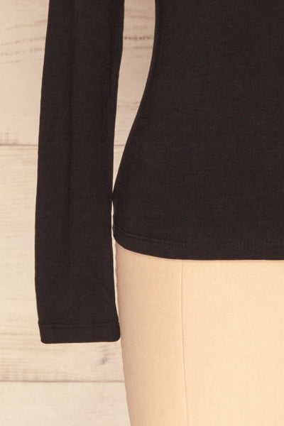 Otwock Black Long Sleeved Top | La Petite Garçonne bottom close-up
