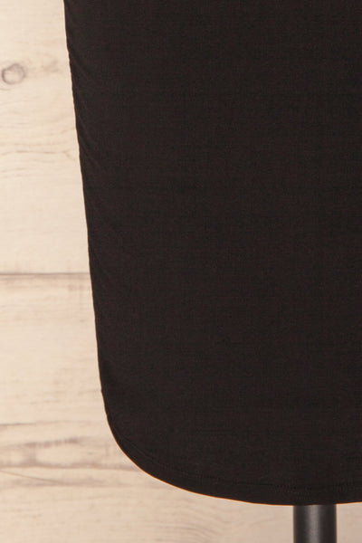 Phoebe Black Short Fitted Dress w/ V-Neck | La Petite Garçonne bottom close-up