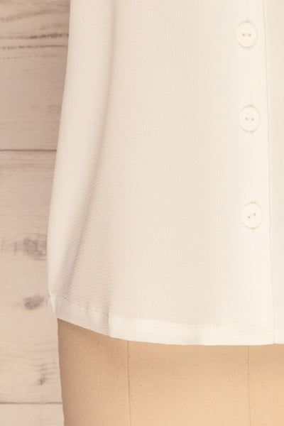 Rosarno White Crepe Short Sleeved Shirt | La petite garçonne bottom close-up