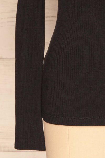 Roust Black Cotton Ribbed Turtleneck Top sleeve close up | La Petite Garçonne