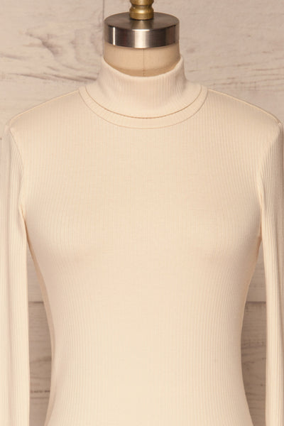 Roust Cream Cotton Ribbed Turtleneck Top front close up | La Petite Garçonne