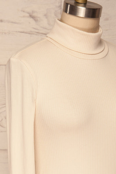 Roust Cream Cotton Ribbed Turtleneck Top side close up | La Petite Garçonne