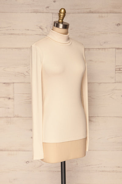 Roust Cream Cotton Ribbed Turtleneck Top side view | La Petite Garçonne