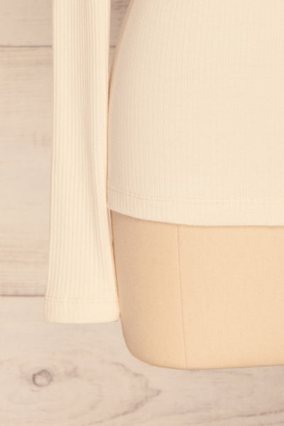 Roust Cream Cotton Ribbed Turtleneck Top sleeve close up | La Petite Garçonne
