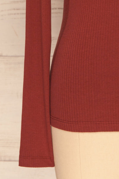 Roust Rust Cotton Ribbed Turtleneck Top sleeve close up | La Petite Garçonne
