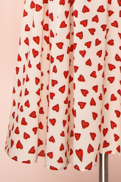 Simonette Ivory Red Heart Pattern Midi Dress | Boutique 1861 bottom close-up