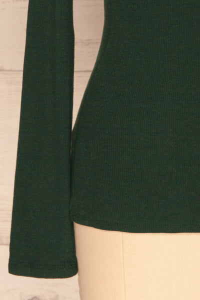 Sliema Green Turtleneck Ribbed Knit Top | La Petite Garçonne bottom close-up