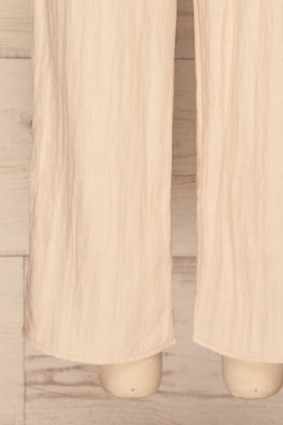 Tarja Sand Beige Short Sleeve Jumpsuit | La petite garçonne bottom close-up