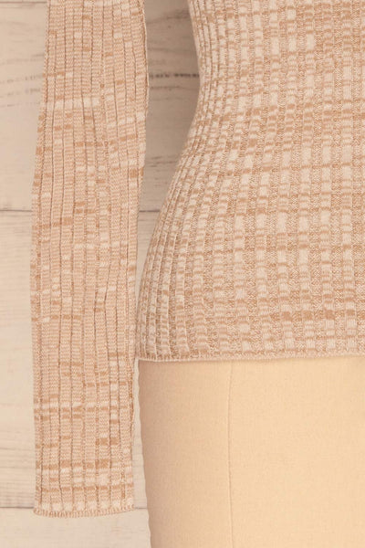 Tomsk Beige Turtleneck Top | Haut | La Petite Garçonne bottom close-up