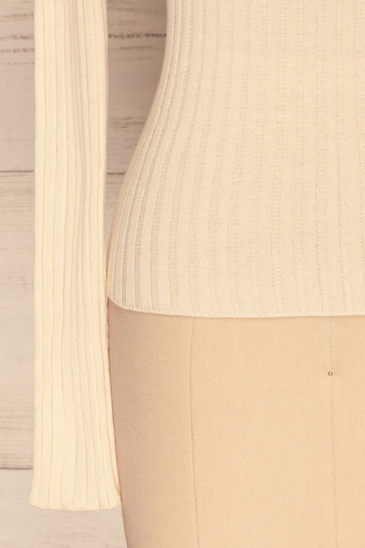 Tomsk Cream Turtleneck Top | Haut | La Petite Garçonne bottom close-up