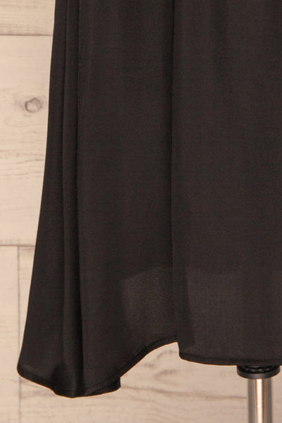 Udine Onyx Black Midi Dress | Robe Noire skirt close up | La Petite Garçonne