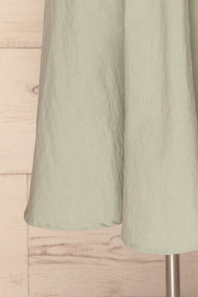 Valthi Blue Linen A-Line Midi Dress | La petite garçonne bottom close-up
