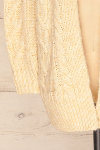 Varvarin Cream Knit Cardigan | La Petite Garçonne bottom close-up