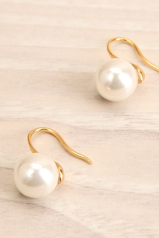 Azerro Gold Pearl Pendant Earrings close-up | La Petite Garçonne